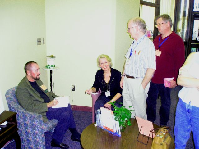 Ingo Swann with admirers at the 2003 Remote Viewing Conference